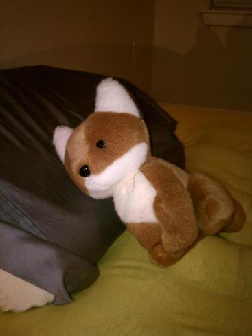 Sleepy fox stuffed animal